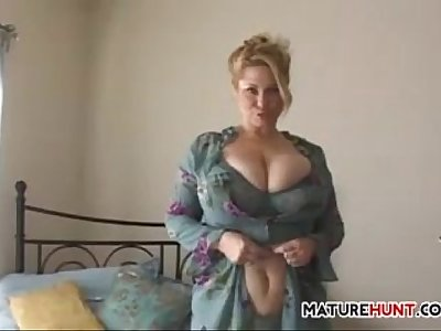 Busty Mature Blonde Strips And Masturbates