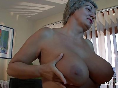 Mature slut gets cum on her huge tits