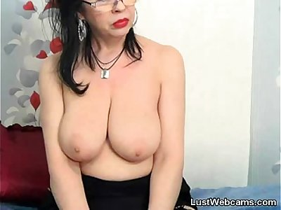 Busty mature plays with her pussy on cam
